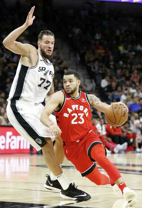 San Antonio SpursÕ Joffrey Lauvergne defends Toronto RaptorsÕ Fred VanVleet during second half action Monday Oct. 23, 2017 at the AT&T Center. The Spurs won 101-97. Photo: Edward A. Ornelas, Staff / San Antonio Express-News / © 2017 San Antonio Express-News