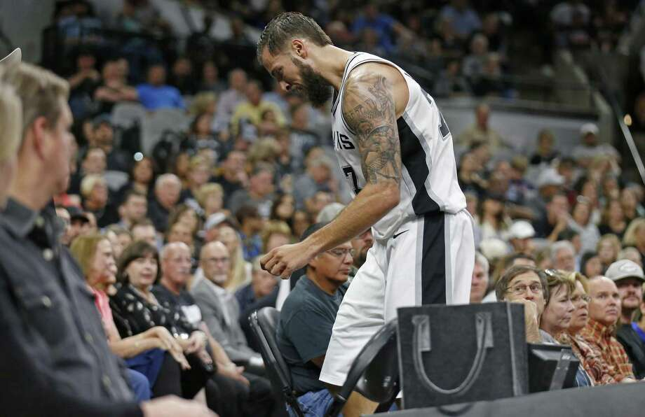 San Antonio SpursÕ Joffrey Lauvergne walks off the court after being injured on a play during second half action against the Toronto Raptors Monday Oct. 23, 2017 at the AT&T Center. The Spurs won 101-97. Photo: Edward A. Ornelas, Staff / San Antonio Express-News / © 2017 San Antonio Express-News