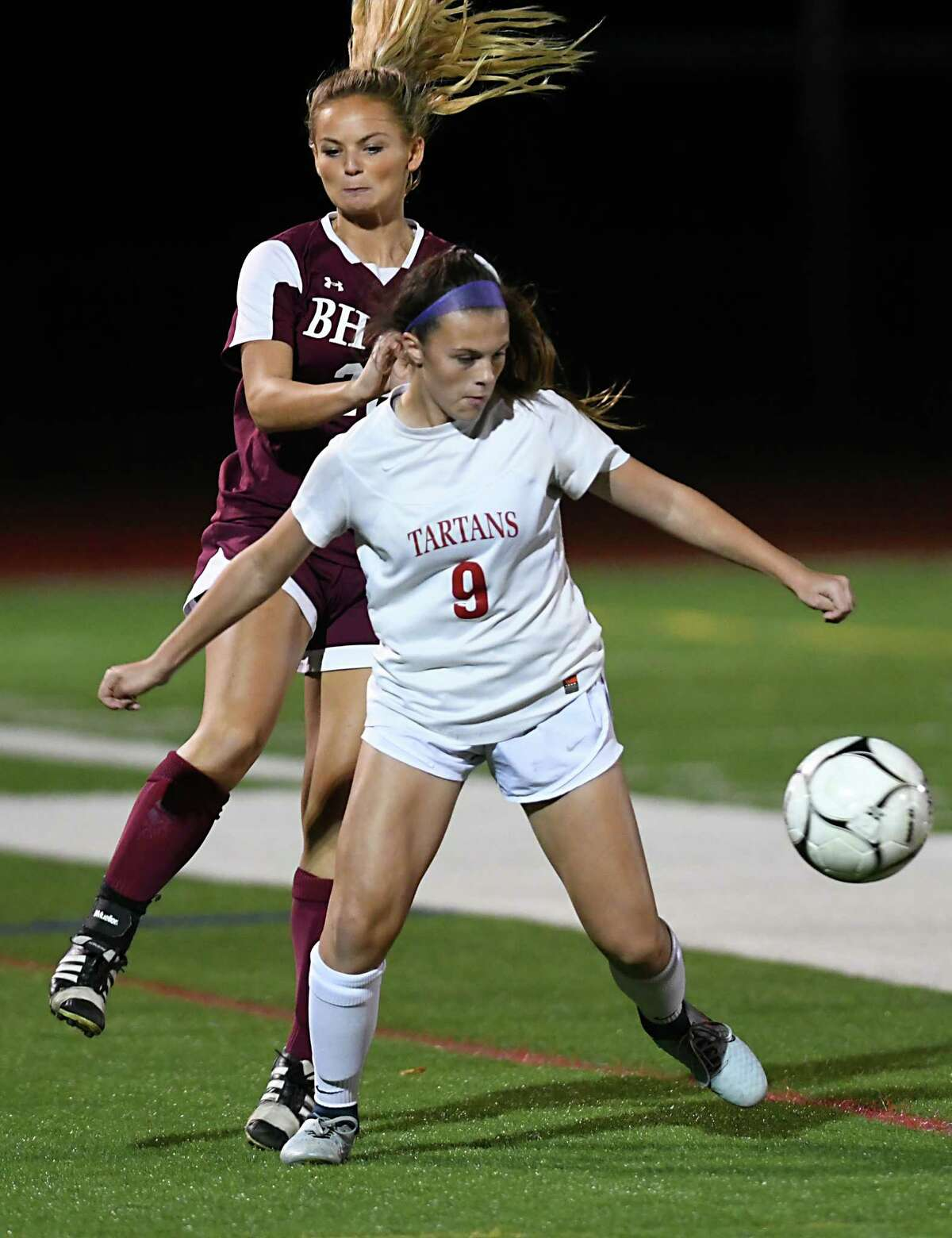 Burnt Hills' Molly Garis, left, battles for the ball with Scotia's Rylee O'Connor during a semi-final soccer game on Monday, Oct 23, 2017 in Stillwater, N.Y. (Lori Van Buren / Times Union)
