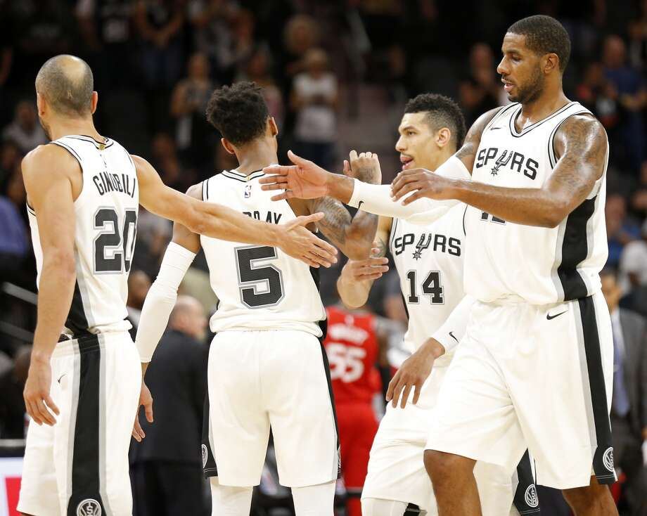 San AntonioSpurs' Manu Ginobili (from left), Dejounte Murray, Danny Green, and LaMarcus Aldridge walk to the bench during a second half action timeout against the Toronto Raptors Monday Oct. 23, 2017 at the AT&T Center. TheSpurswon 101-97.