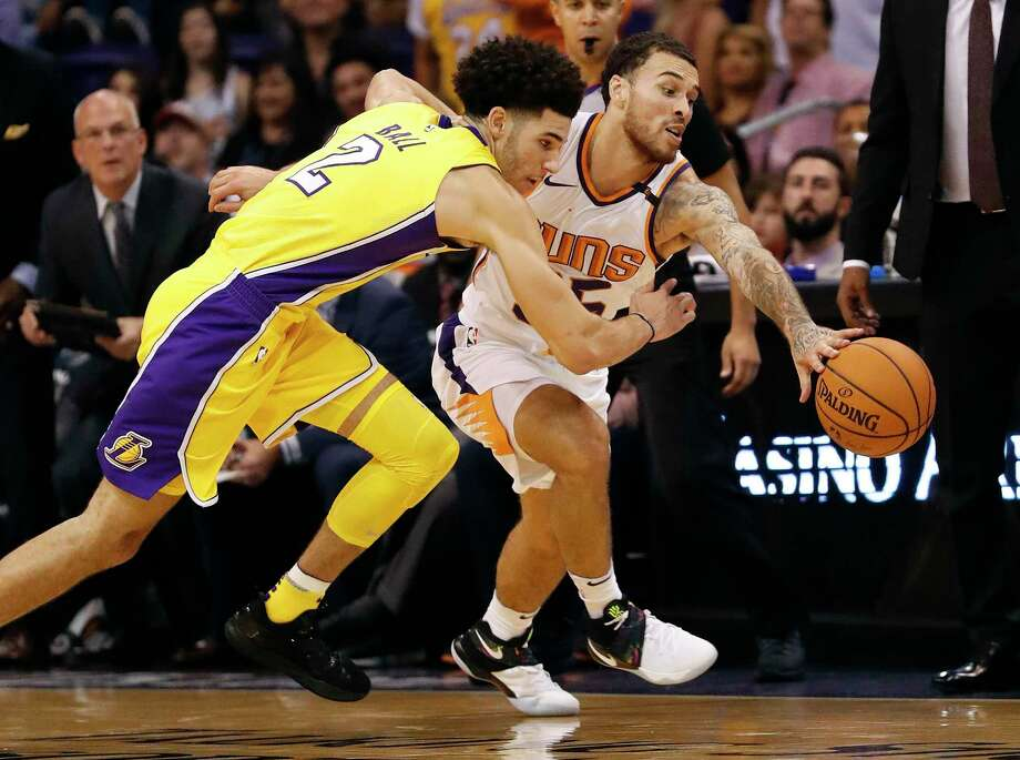 Phoenix Suns guard Mike James steals the ball from Los Angeles Lakers guard Lonzo Ball (2) during the second half of an NBA basketball game, Friday, Oct. 20, 2017, in Phoenix. (AP Photo/Matt York) Photo: Matt York, Associated Press / Copyright 2017 The Associated Press. All rights reserved.