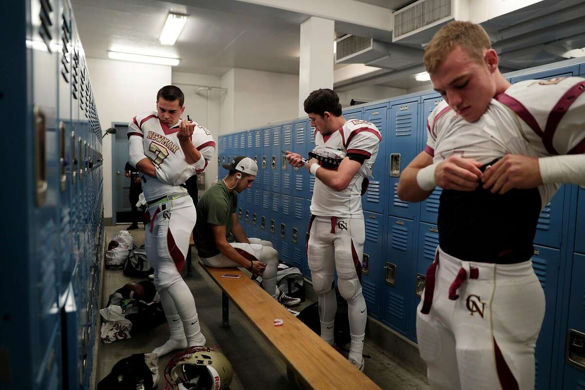 Quarterback Beau Barrington (7), wider reciever Kyle Carinalli (23) and Tanner Mendoza (2) get ready for the gam as Cardinal Newman High School played its first football games against Rancho Cotati High School in Rohnert Park, Calif., Monday, October 23, 2017. The games were the first for the school which was destroyed during the deadly fires that devastated the country and Santa Rosa.