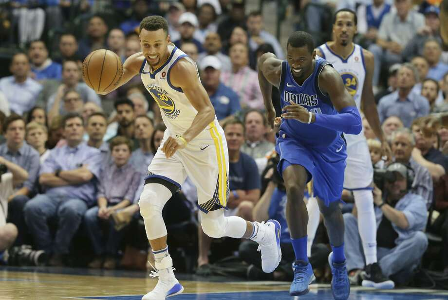 Golden State Warriors guard Stephen Curry (30) comes up with the loose ball against Dallas Mavericks forward Harrison Barnes (40) during the first half of an NBA basketball game in Dallas, Monday, Oct. 23, 2017.  Photo: LM Otero, Associated Press