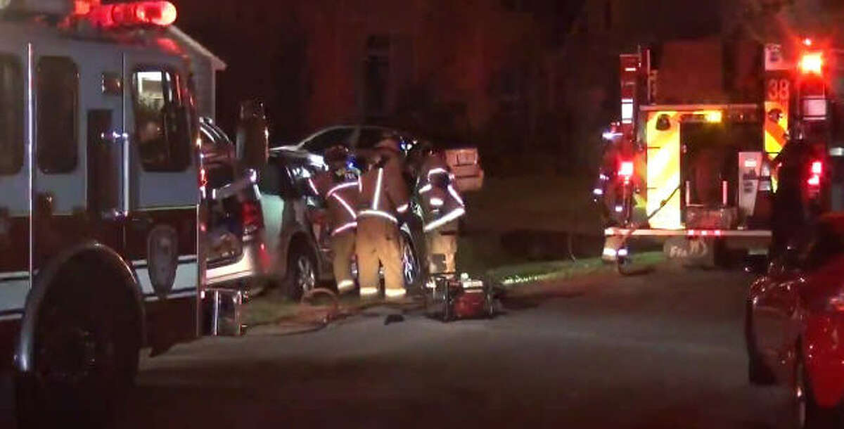 Fire crews pulled a woman from the wreckage after a hit-and-run.