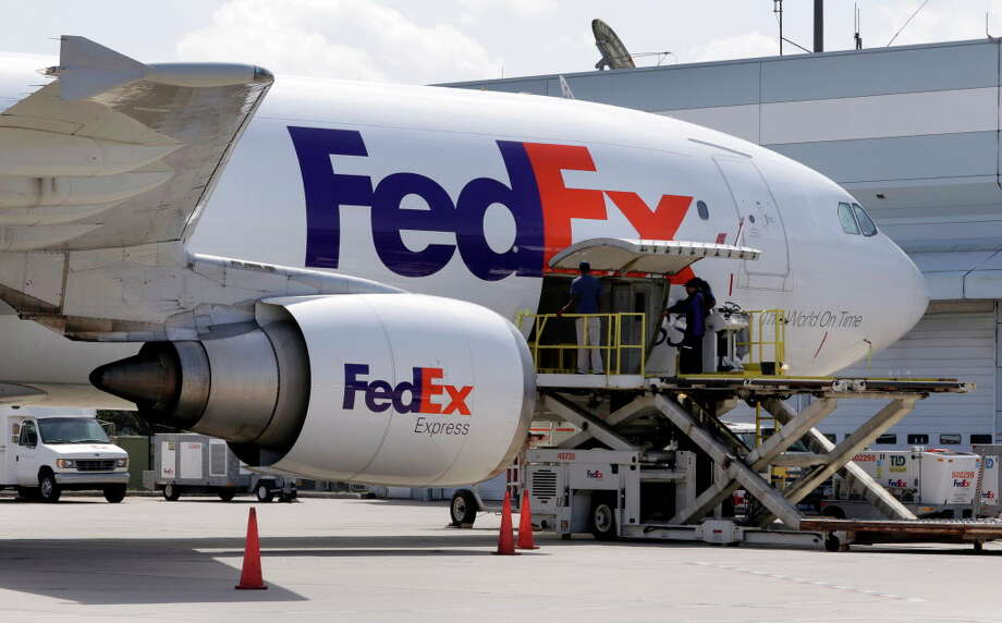 A FedEx plane is loaded at the Central Cargo Facility, the older and smaller of two cargo facilities at George Bush Intercontinental Airport. On Tuesday morning, the Montgomery County Commissioners Court discussed a tax abatement for an $18 million FedEx facility to be built in Conroe. Photo: Michael Wyke, Freelance / © 2017 Houston Chronicle