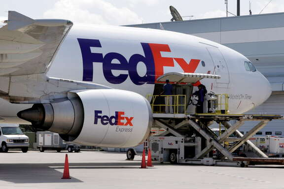 A FedEx plane is loaded at the Central Cargo Facility, the older and smaller of two cargo facilities at George Bush Intercontinental Airport. On Tuesday morning, the Montgomery County Commissioners Court discussed a tax abatement for an $18 million FedEx facility to be built in Conroe.