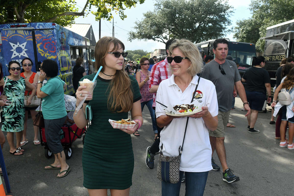 Jessica Roche, left, and her mom Tina share the sights and sounds during the Tomball Food Truck Fest near the downtown Depot on Oct. 21, 2017. (Photo by Jerry Baker/Freelance)