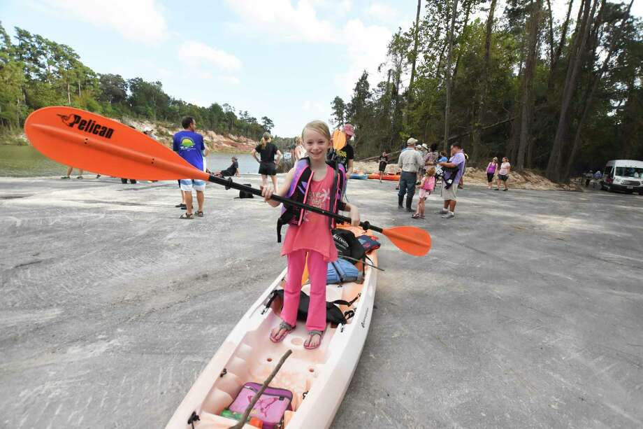 Tallulah Woolley practices paddling for her first canoe trip.  Residents had the chance Oct. 21 to join Harris County Precinct 4 Commissioner Jack Cagle and kick-off the cooler weather by paddling in canoes along Spring Creek to where Spring Creek and Cypress Creek meet along the Spring Creek Greenway. Photo: Tony Gaines/ HCN, Photographer