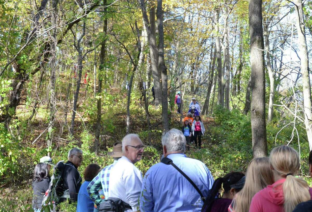 Some of the 100 people attending Saturday's grand opening of the Mohawk Hudson Land Conservancy's 18th preserve, the Fox Preserve in the town of Colonie along the Shaker Creek, walk the trails. Assemblyman Phil Steck, Mohawk Hudson Land Conservancy Executive Director Mark King and land donor Dr. Patricia Fox, a local plastic surgeon, attended the event, which included guided hikes through the old growth forests. Fox donated the land she owned on River Road in Latham for over 30 years to the Conservancy in 2015. She spoke of her initial vision when purchasing the land;