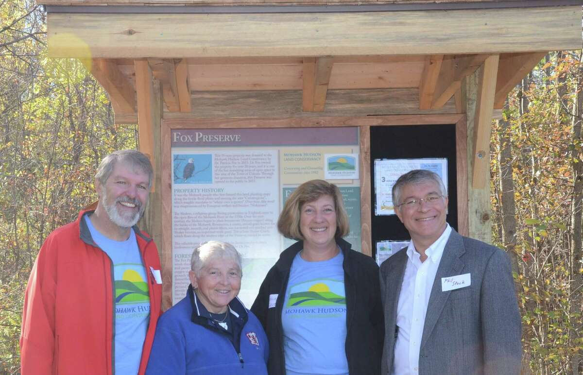 Mark King, Dr. Patricia Fox, Cathie Love and Phul Steck were among about 100 people attending Saturday's grand opening of the Mohawk Hudson Land Conservancy's 18th preserve, the Fox Preserve in the town of Colonie along the Shaker Creek. Assemblyman Phil Steck, Mohawk Hudson Land Conservancy Executive Director Mark King and land donor Dr. Patricia Fox, a local plastic surgeon, attended the event, which included guided hikes through the old growth forests. Fox donated the land she owned on River Road in Latham for over 30 years to the Conservancy in 2015. She spoke of her initial vision when purchasing the land;