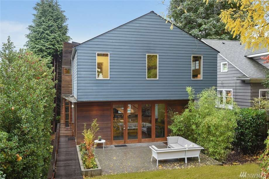This modern home has a spacious main level that opens up to a patio through a series of folding glass and fir doors. That's on top of the park-like views of the private yard from the dining room and kitchen, the Brazilian walnut floors and the gas fireplace.The address is 1839 23rd Ave. E., listed for $1,300,000. See the full listing below. Photo: Listing Provided Courtesy Of Mark Hobbs, Windermere Real Estate Co.