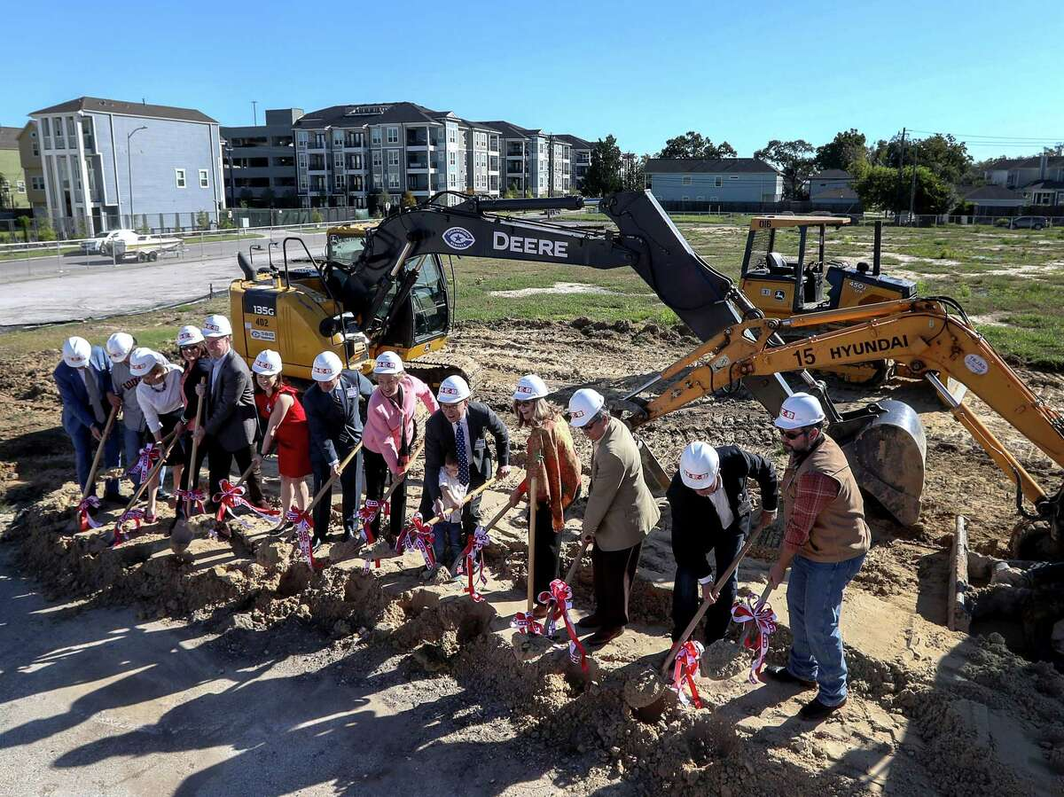 A groundbreaking ceremony for a new HEB location in the Heights neighborhood is seen , Tuesday, Oct. 24, 2017, in Houston. Last November, Heights residents voted to repeal an alcohol ban, making it possible for HEB to build the store. ( Jon Shapley )