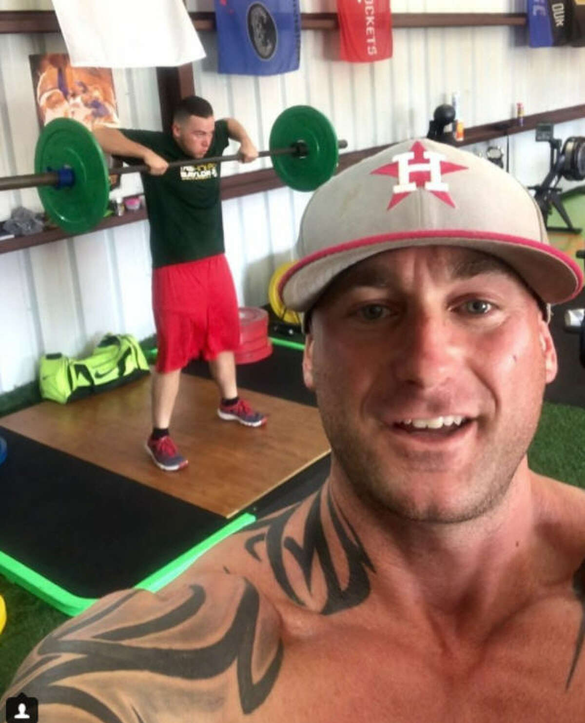 Business owner and physical trainer Brandon Berryhill knows his twin brother Kenneth, who died 22 years ago almost to the date, would have loved to see their Houston Astros reach the Fall Classic.