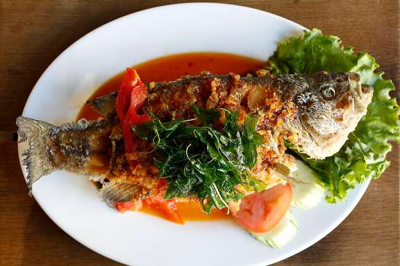 Pla Sam Ros--a sweet and sour black sea bass with crispy basil leaves, a Northeastern Thai dish--made by chef Chanon Hutasingh at Esan on Wednesday, August 30, 2017, in San Francisco, Calif.