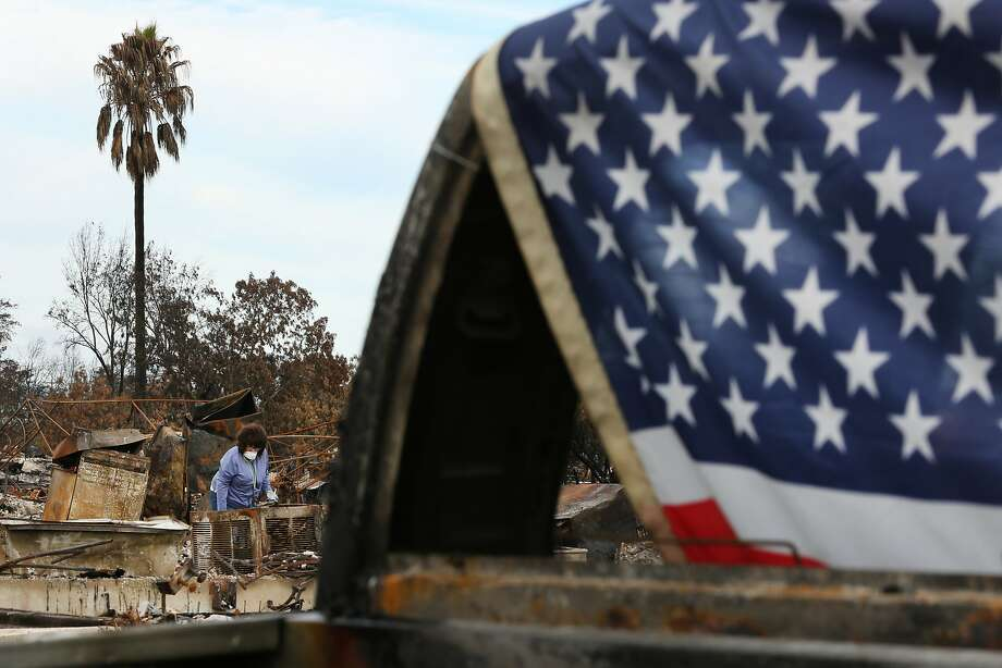 Donna Pittman searches in the rubble of her home for belongings in the Coffey Park neighborhood on Friday, Oct. 20, 2017, in Santa Rosa. With hot weather enveloping the Bay Area, firefighters are working to put out the last hotspots of the destructive wildfires that swept through the Wine Country. Photo: Santiago Mejia, The Chronicle