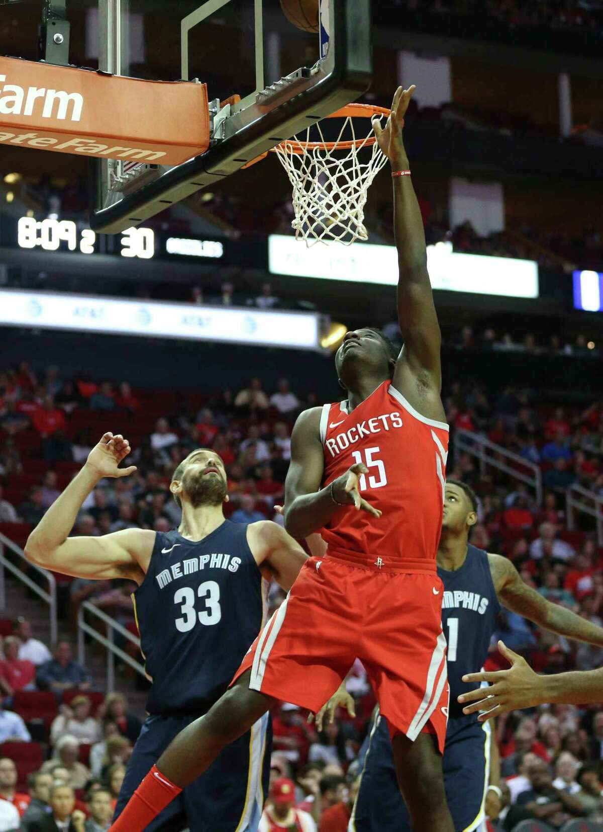 Rockets center Clint Capela is better equipped to butt heads with beefier NBA centers like the Grizzlies' 7-1, 255-pound Marc Gasol, left.