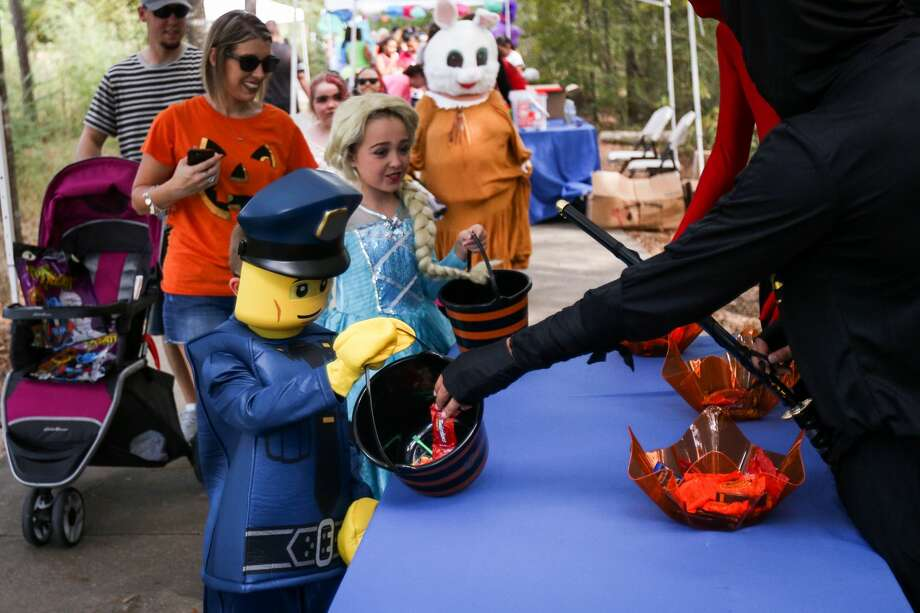 Caten Cartwright, 6, dressed as a LEGO person, walks through the annual Trick or Treat Trail on Saturday, Oct. 21, 2017, at Carl Barton Jr. Park in Conroe. Photo: Michael Minasi/Houston Chronicle