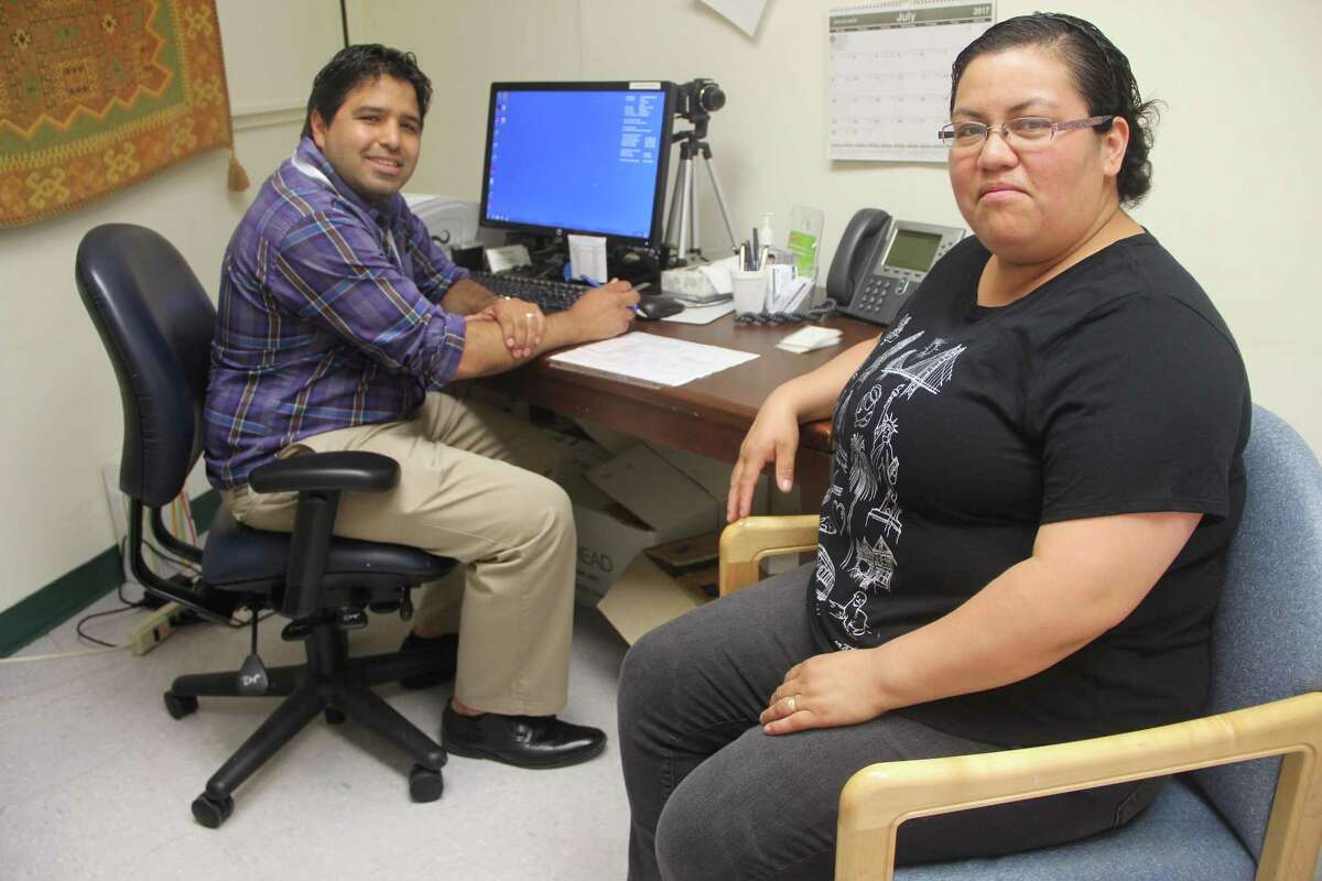 Navigators at Project Access New Haven meet with economically disadvantaged patients at Yale New Haven Hospital. Jova Perez, right, a mother of two from New Haven, has a consultation with navigator Juan Carmona, who is guiding her through her breast cancer treatment and follow-up.
