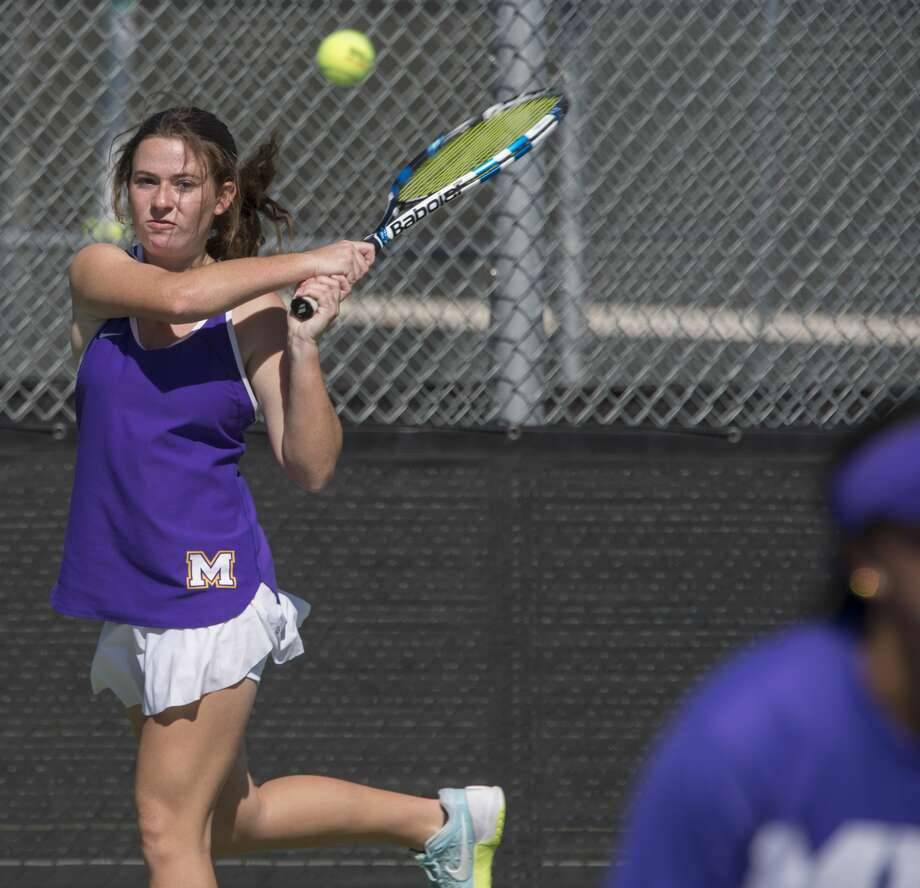 Laney Gordon returns a shot 10/24/17 during her doubles match with Shannon Hickey in a quaterfinal match against El Paso Franklin. Tim Fischer/Reporter-Telegram Photo: Tim Fischer/Midland Reporter-Telegram