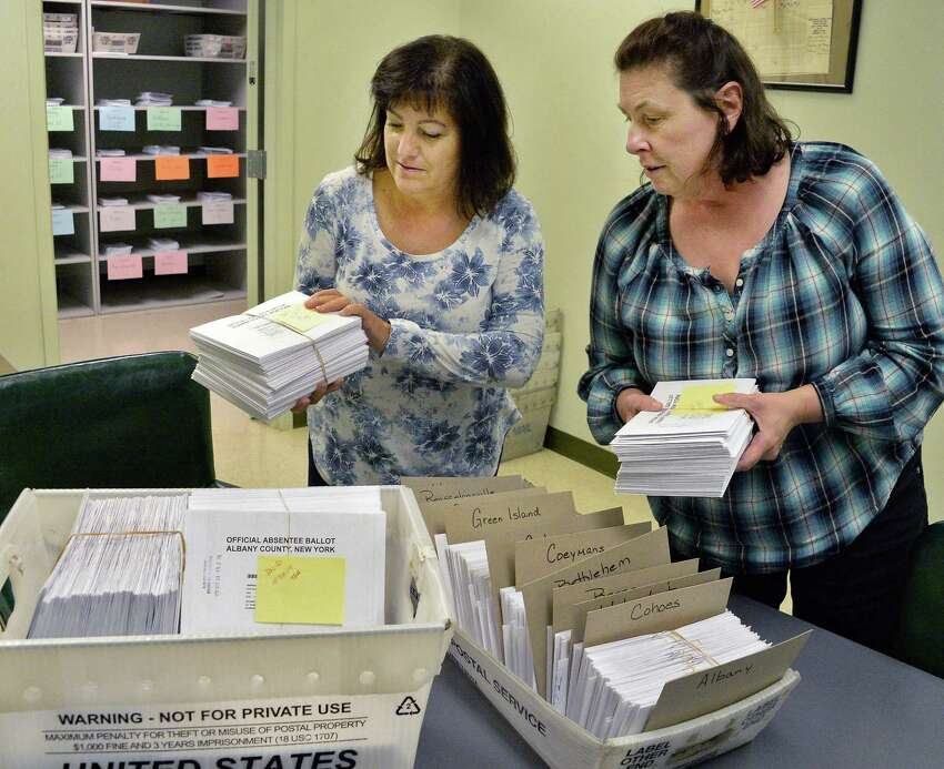 Supervising election specialists Dorothy Earnest, left, and Debbie Smith process absentee ballots at the Albany County Board of Elections Tuesday Oct. 24, 2017 in Albany, NY. (John Carl D'Annibale / Times Union)