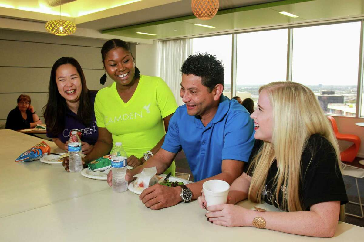Staff members Connie Chau, from left, Danielle Rivers, Carlos Portillo and Makinsey Aronson visit and enjoy lunch at the Camden Cafe, at Camden Property Trust headquarters at 11 Greenway Plaza. (For the Chronicle/Gary Fountain, October 9, 2017)