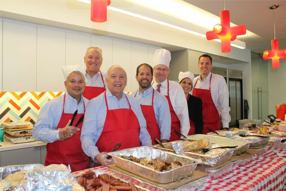 Leaders from G&A Partners, a Chronicle Top Workplaces winner in 2017, serve lunch during Administrative Professionals Day. Photo: G&A Partners