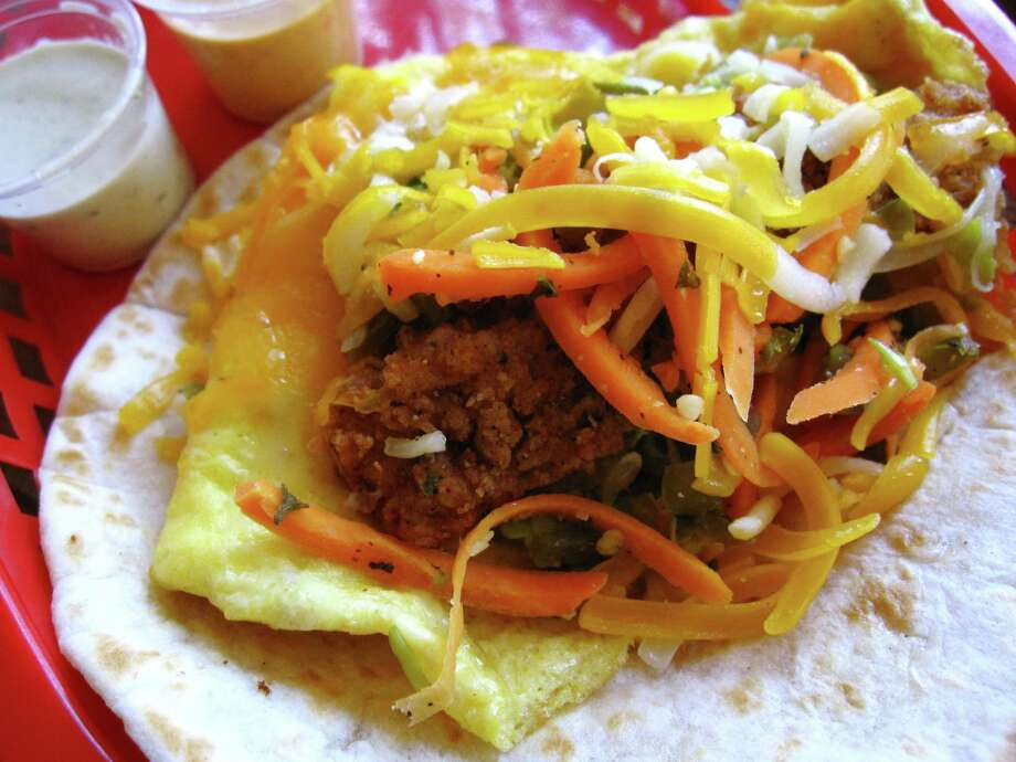 932b37592f67 The Dirty Sanchez breakfast taco at Torchy s Tacos with a fried poblano  pepper