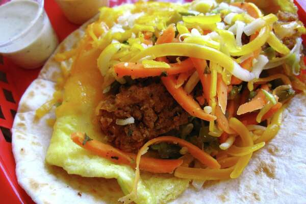 The Dirty Sanchez breakfast taco at Torchy's Tacos with a fried poblano pepper, eggs, cheese and carrot escabeche on a flour tortilla. Torchy's Tacos will open a third San Antonio location on the North Side in the Sonterra neighborhood.