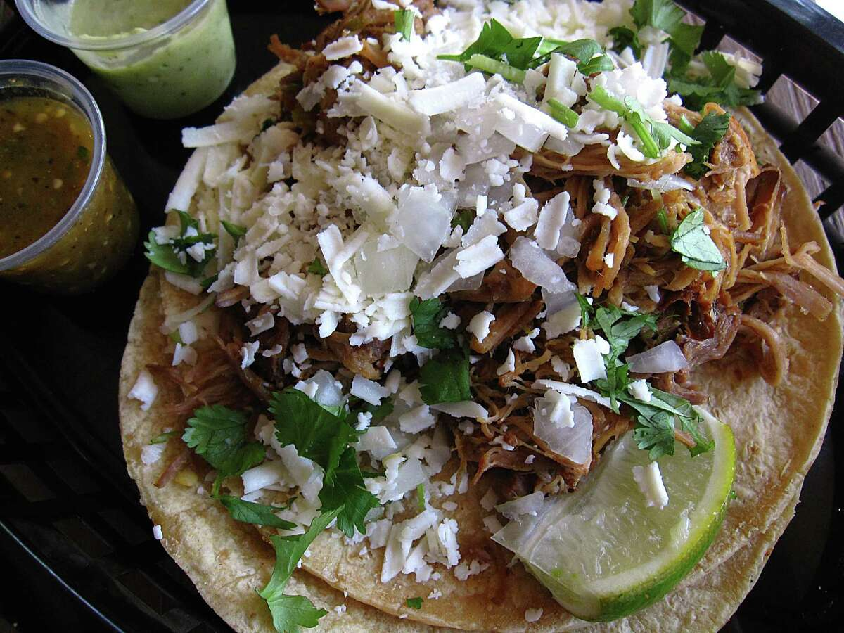 Green chile pork taco on doubled-up corn tortillas from Torchy's Tacos.