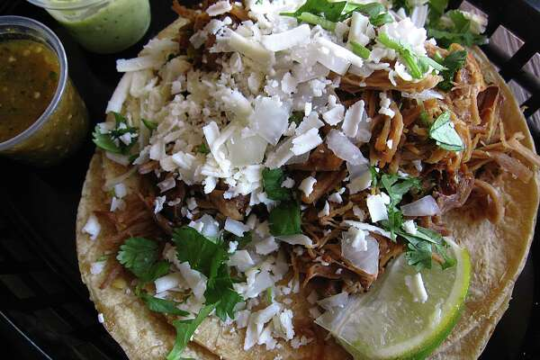 90742c688002 3of82Green chile pork taco on doubled-up corn tortillas from Torchy s Tacos.Photo   Mike Sutter  Staff