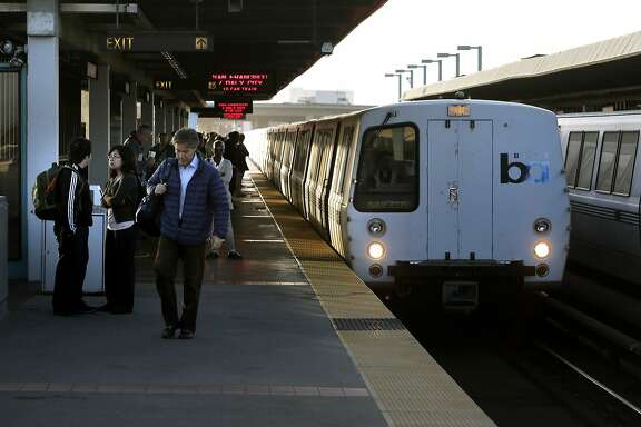 Riders prepare to board an approaching San Francisco bound train at the West Oakland station, in Oakland, Calif. on Thurs. September 3, 2015. With gas prices low, travel is expected to be up, especially by car. Folks sticking around the Bay Area could also encounter chaos when BART will shut down the Transbay Tube for three days for repairs.