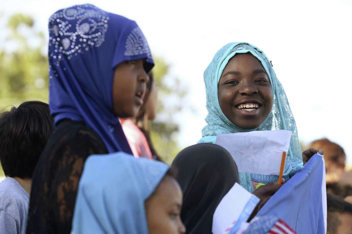 Reahama Yussufu, 9, smiles as she represents Somalia during the Parade of Nations at Colonies North Elementary School, Tuesday, Oct. 24, 2017. Forty nations were represented in the parade.