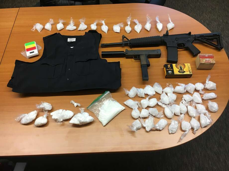Inside the Seguin home, officers seized a bulletproof vest, three pounds of methamphetamine, one pound of cocaine, about $1,000 in cash, a semi-automatic rifle and an Uzi submachine gun with a suppressor and extended ammo magazine. Photo: Seguin Police Department