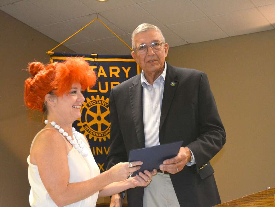 Mayor Wendell Dunlap presents Plainview Rotary President Kim Street, in costume as Wilma Flintstone, with a mayoral proclamation designating Tuesday, Oct. 24, 2017, as World Polio Day in Plainview. The presentation came during Plainview Rotary Club's noon meeting. The proclamation notes that since Rotary International launched its Polio Plus initiative in 1988 to eradicate the disease globally, instances of the illnesses have declined 99.9 percent with more than 2.5 billion children in 122 counties receiving vaccine. Polio has now been eradicated in all but three countries – Pakistan, Afghanistan and Nigeria – with only 12 people newly diagnosed thus far this year. Only one new case was reported worldwide this week, in Afghanistan. The instances of newly diagnosed cases of polio have falling in recent years from 259 in 2014, to 74 in 2015, and 37 in 2016. Cost of vaccine is just 60 cents per dose.