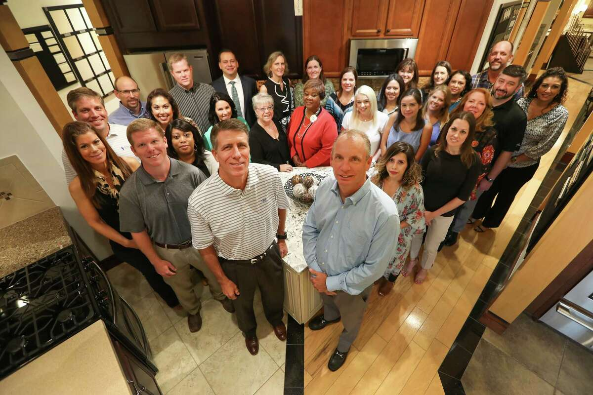Newmark Homes President Mike Moody (left, foreground) and Vice President Jeff Dye (right, foreground) are surrounded by their management team Wednesday, Sept. 27, 2017, in Houston. Newmark Homes were selected one of the Houston Chronicle's Top Workplaces. ( Steve Gonzales / Houston Chronicle )
