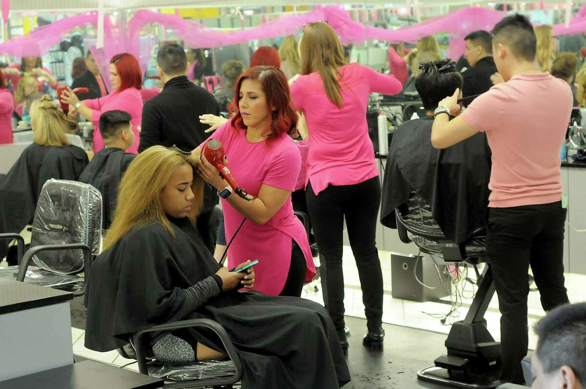 Cindy Nicasio styles Summer Taylor's hair at Memorial City Mall.