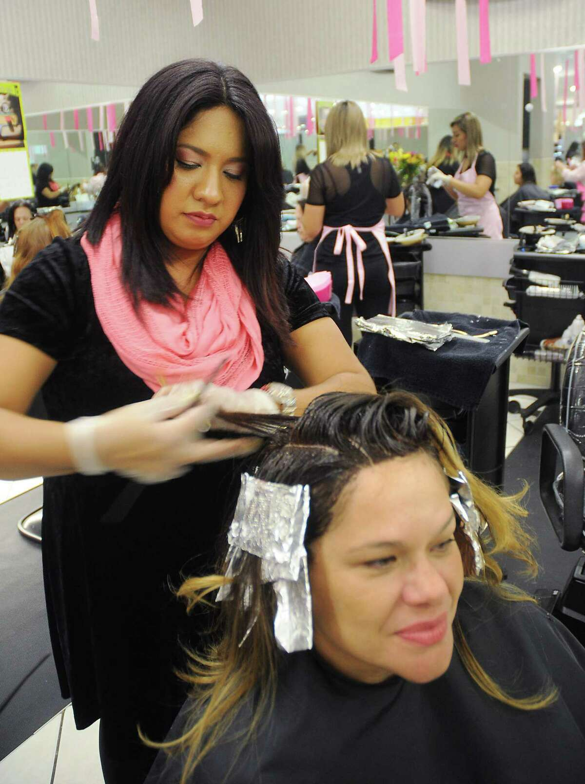 Kristen Sanchez has her hair colored by Elizabeth Cruz at Visible Changes at Memorial City Mall Saturday Sept. 30, 2017.(Dave Rossman Photo)