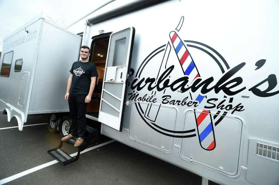 Cameron Burbank, founder and CEO of Burbank's Mobile Barber Shop, is photographed at his business in the parking lot of Quinnipiac University's Hilltop parking area in Hamden Tuesday. Photo: Arnold Gold / Hearst Connecticut Media / New Haven Register