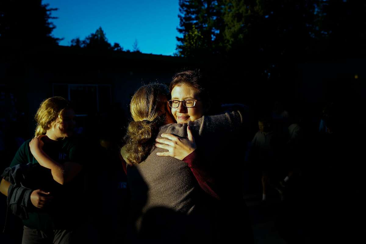 Teacher and mother Jennifer Freese (right) is embraced by a teacher on her first day back at work since her home was destroyed in the Tubbs fire in Healdsburg, Calif., on Tuesday, Oct. 24, 2017. The Freese family lost their home in the Tubbs fire and have been living in a house that was lent to them by a friend of their church. Jennifer and her husband Sean also lost their home in Hurricane Katrina when they were living in New Orleans.