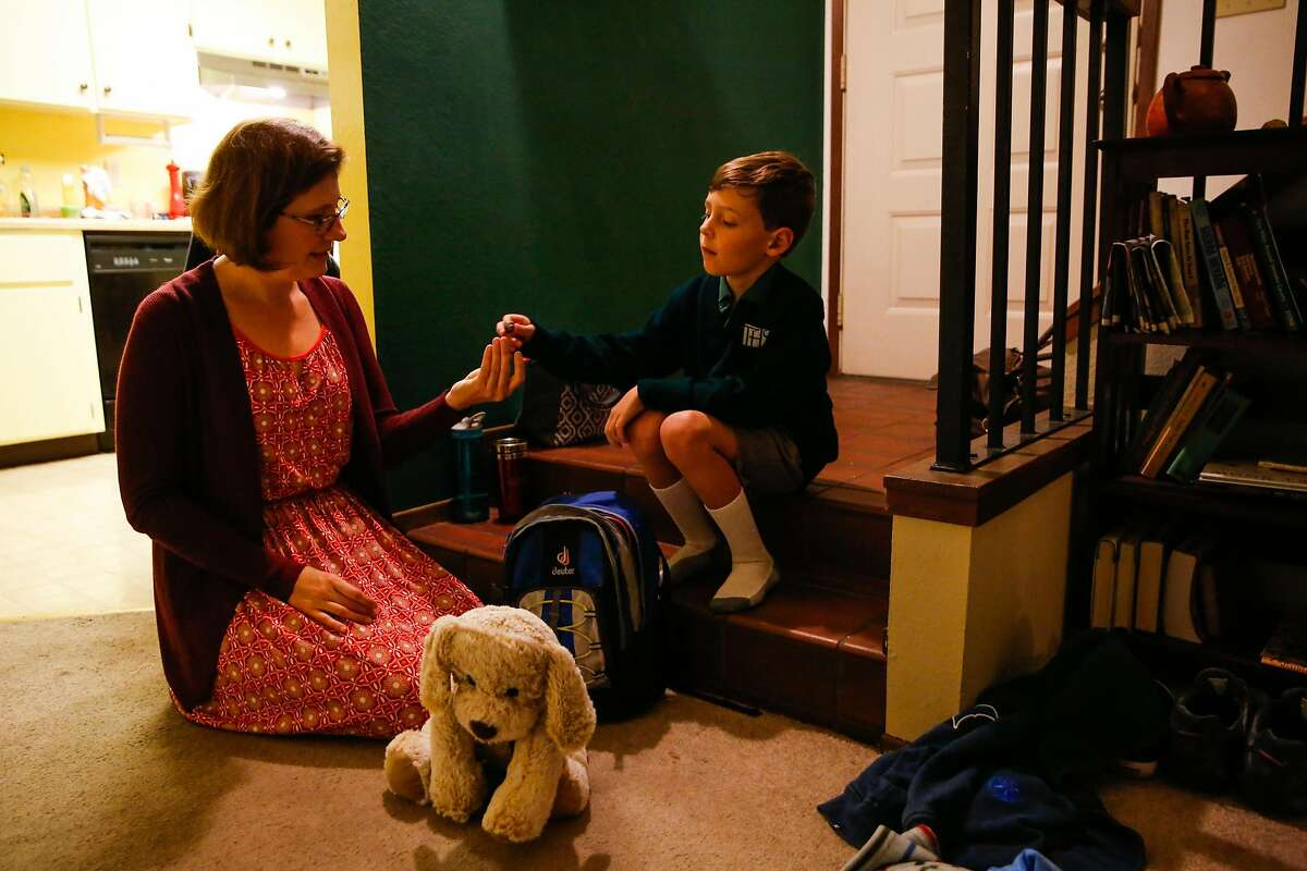 Jennifer Freese shows her son Owen Freese, 6, her wedding ring that her husband Sean (not pictured) found among the rubble of their destroyed home, while getting ready for school at their temporary house in Rohnert Park, Calif., on Tuesday, Oct. 24, 2017. The Freese family lost their home in the Tubbs fire and have been living in a house that was lent to them by a friend of their church. Jennifer and her husband Sean also lost their home in Hurricane Katrina when they were living in New Orleans.
