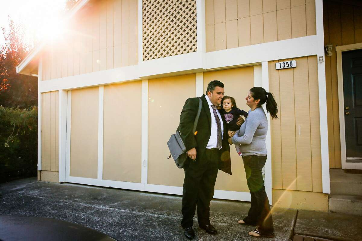 Gabriel Castillo gives a hug goodbye to his daughter Ayla Castillo, 14-months and partner Alea Kelleher (right) outside their temporary house in Rohnert Park, Calif., on Tuesday, Oct. 24, 2017. Gabriel Castillo and his partner Alea Kelleher lost their home in the Tubbs fire.