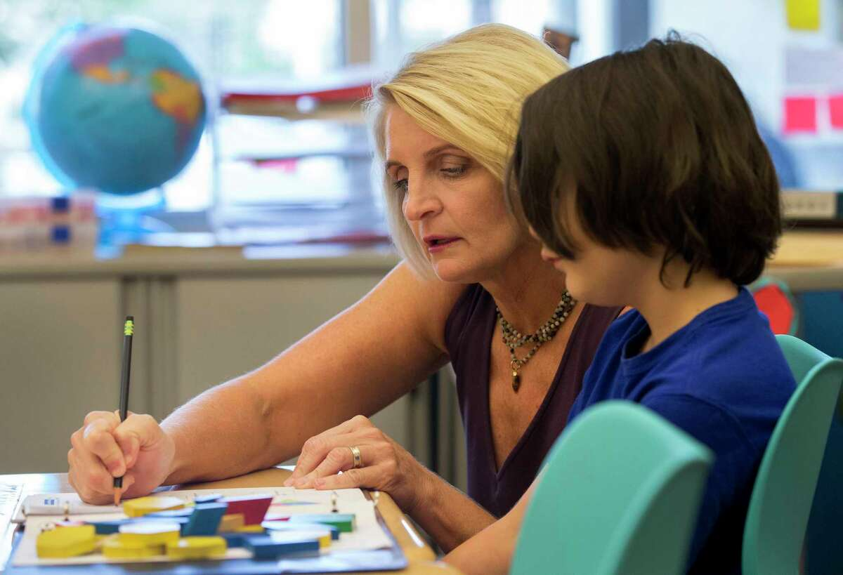 Tammy Christou, center, helps one of her third grade level students at The Joy School Monday, Oct. 2, 2017, in Houston. ( Godofredo A. Vasquez / Houston Chronicle )