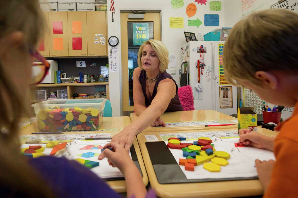 Tammy Christou, center, interacts with students in her third grade level class at The Joy School Monday, Oct. 2, 2017, in Houston. ( Godofredo A. Vasquez / Houston Chronicle )
