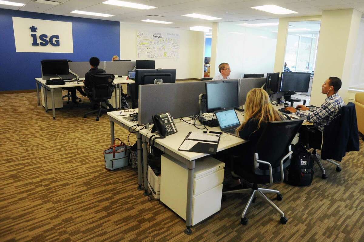 Employees of the technology research and advisory firm ISG work in the firm's Tresser Boulevard offices in downtown Stamford, Conn., on Tuesday, Oct. 24, 2017. ISG has announced it will relocate its Stamford headquarters from 281 Tresser Blvd., to 2187 Atlantic St., in the South End of Stamford.
