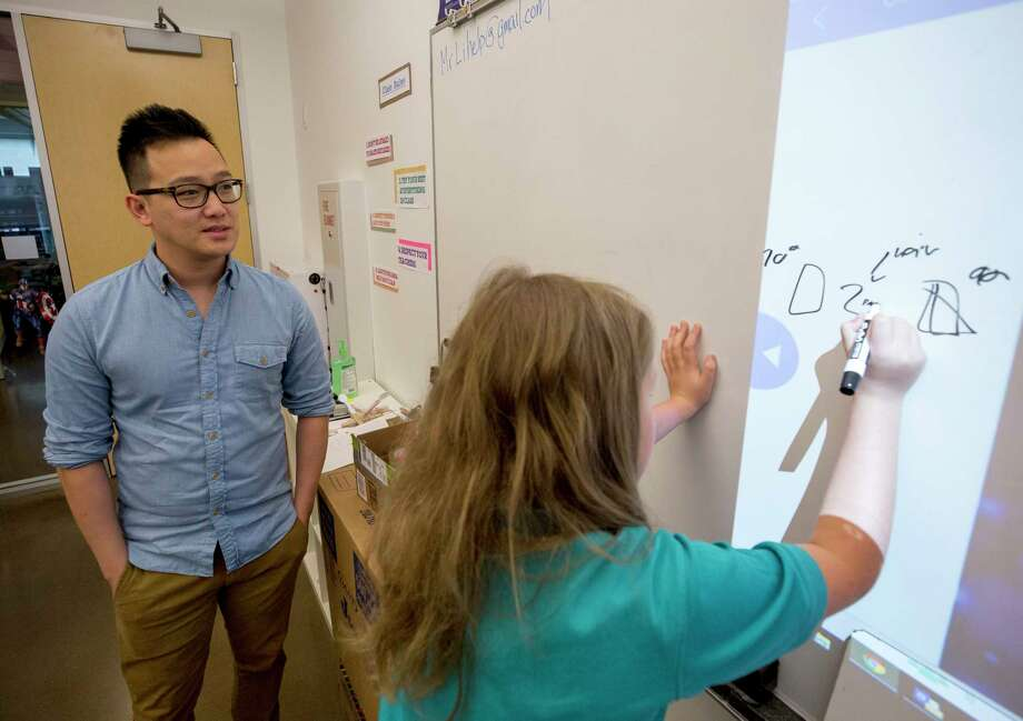 Teacher Jonathan Li listens as a student explains a concept during a science class at The Joy School.  Photo: Godofredo A. Vasquez, Houston Chronicle / Godofredo A. Vasquez