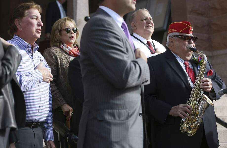 Precinct 2 County Commissioner Paul Elizondo plays the National Anthem Tuesday, Oct. 24, 2017 at the beginning of the news conference announcing his re-election campaign. Photo: William Luther, Staff / San Antonio Express-News / © 2017 San Antonio Express-News