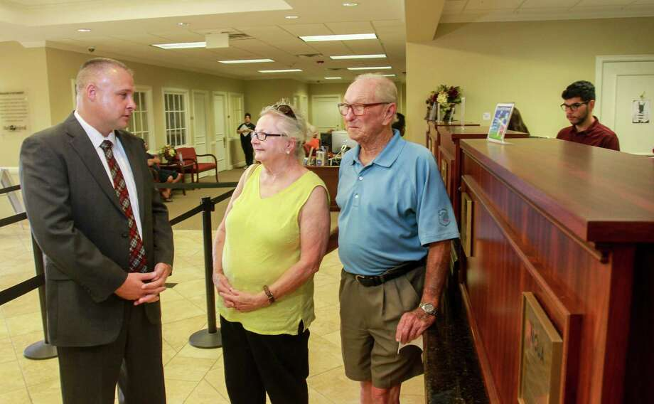 Jose Rodriguez of the Shell Federal Credit Union visits with customers Darla and Milton Oakes. Photo: Gary Fountain, For The Chronicle / Copyright 2017 Gary Fountain