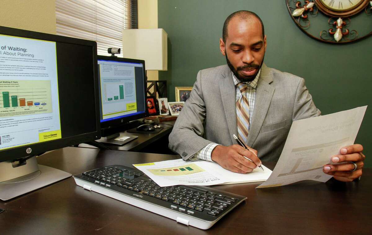 Edward Jones financial adviser Jesse Anglin works on a client review.