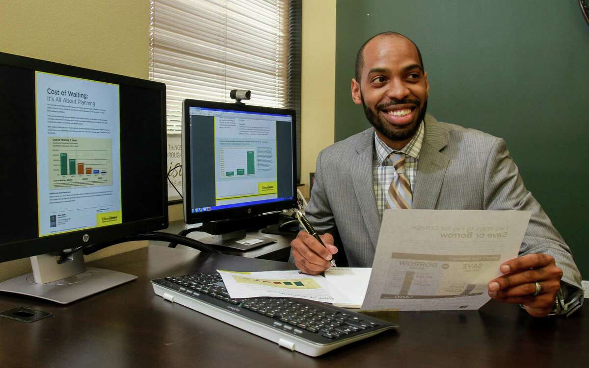 Financial advisor Jesse Anglin of Edward Jones, working in his office on a client review. (For the Chronicle/Gary Fountain, October 6, 2017)