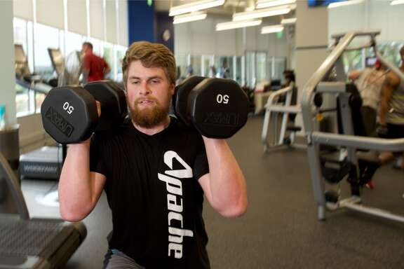 Daniel Matthews, an accountant for Apache Corp., gets in a workout at ApacheFIT. Apache Corp. earned a spot on the Chronicle Top Workplaces list for the second year in 2017.